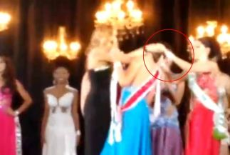Going nuts: The moment runner-up rips crown from beauty queen's head