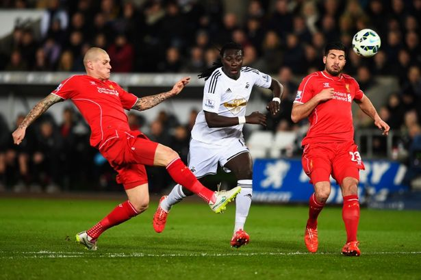 Bafetimbi Gomis is closed down by Martin Skrtel