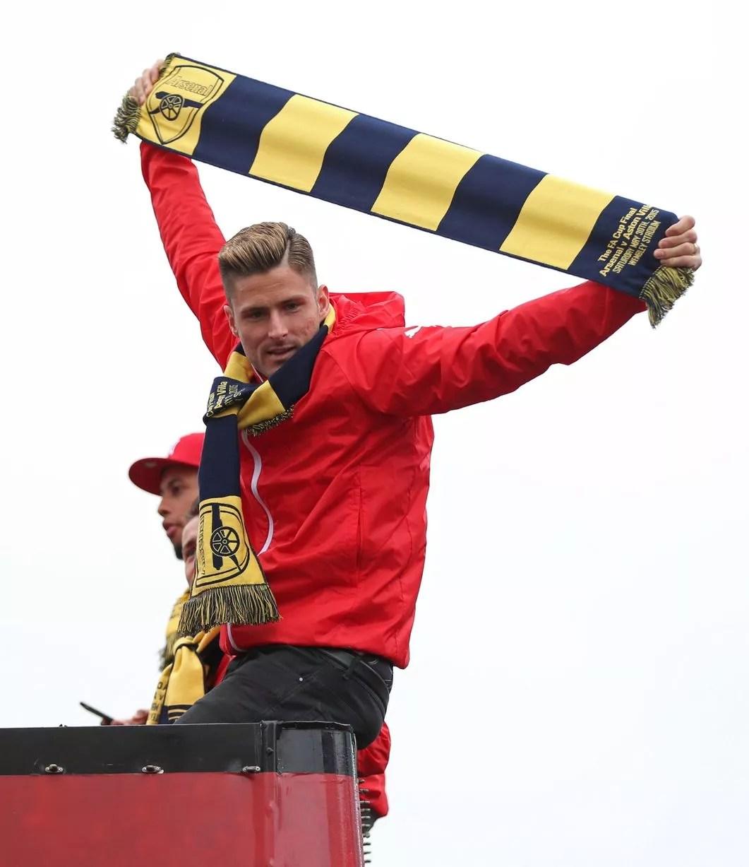 Olivier Giroud celebrates during the parade