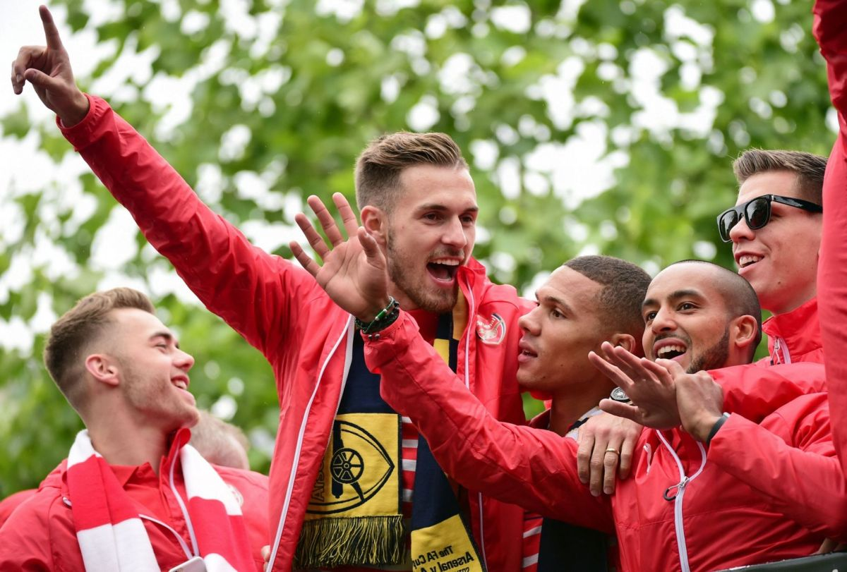 Aaron Ramsey getures to the fans