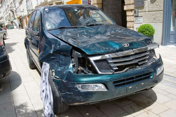 A SUV which drove into pedestrians stands at the scene of crime in the city center of Graz