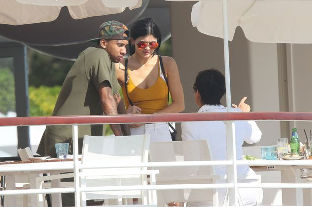 Kylie Jenner and Tyga with Kylie's mother Kris Jenner at the Eden Roc Hotel in Antibes, France