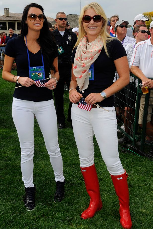 Amanda Dufner and Lindsey Vonn follow the play of the U.S. Team