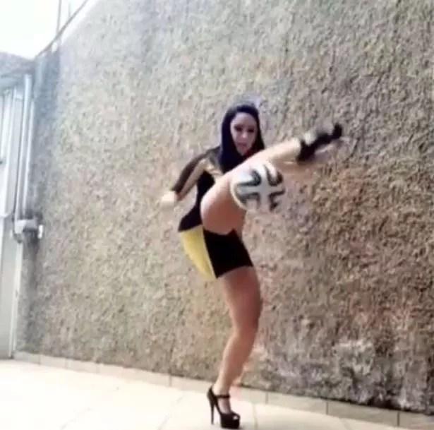 Football Freestyler Raquel Benetti does some keep-ups in high heels