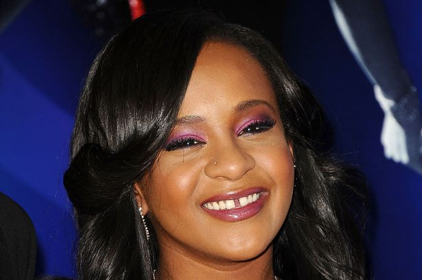 Bobbi Kristina's family banned from her room after photo leak
