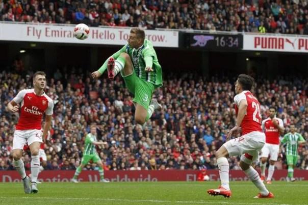 Nicklas Bendtner jumps to control the ball