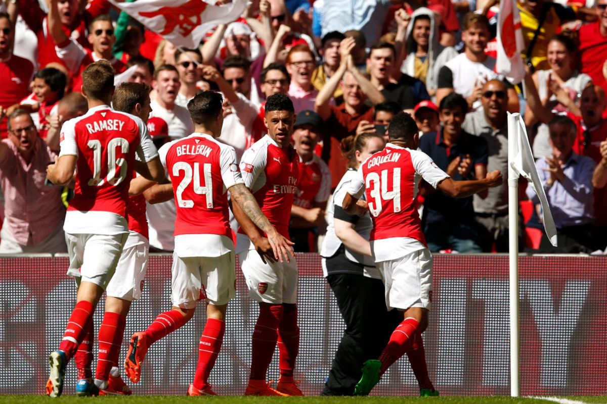 Alex Oxlade-Chamberlain celebrates with team mates after scoring the first goal