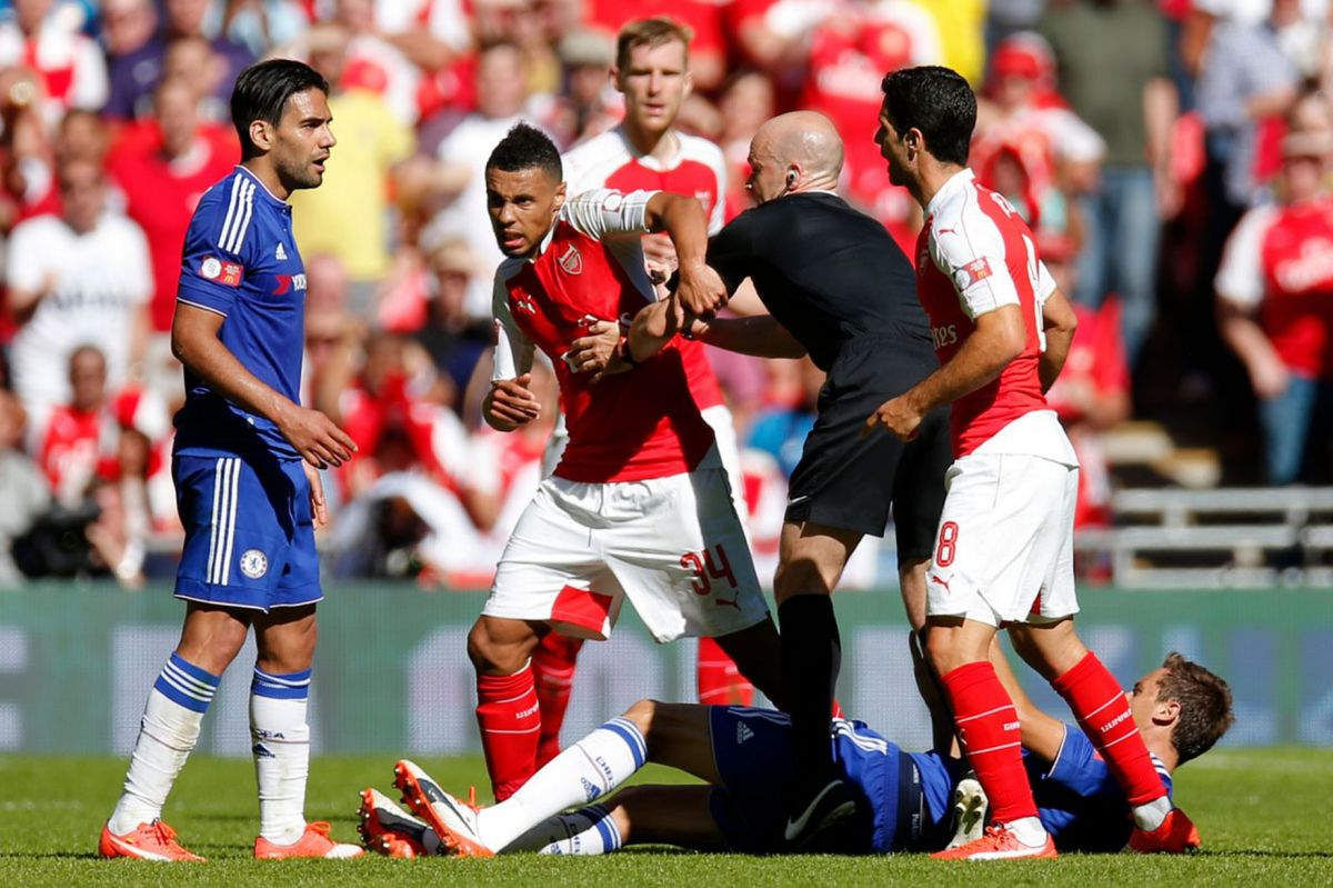 Francis Coquelin clashes with Radamel Falcao as referee Anthony Taylor steps in
