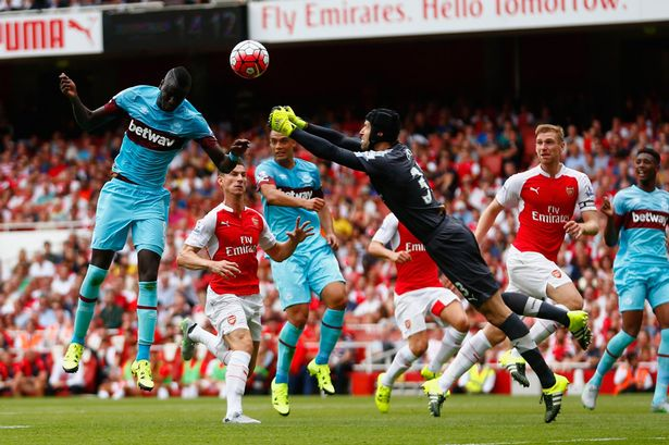 Petr Cech fails to punch clear the ball as Cheikhou Kouyate heads in the opening goal