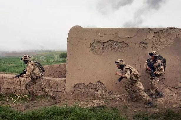 British Marines run under fire from Taliban