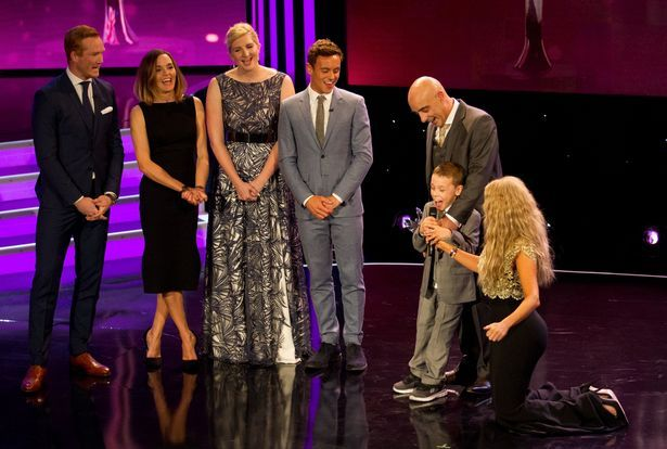 Child of Courage award winner Bailey Matthews on stage with his father along with Carol Vorderman (R) and from left Greg rutherford, Victoria Pendleton, Rebecca Adlington, Tom Daley