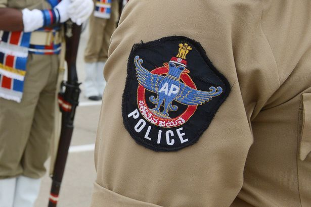 Indian policemen pay homage during a parade to police martyrs on the occasion of National Police Commemoration Day in Hyderabad on October 21, 2013
