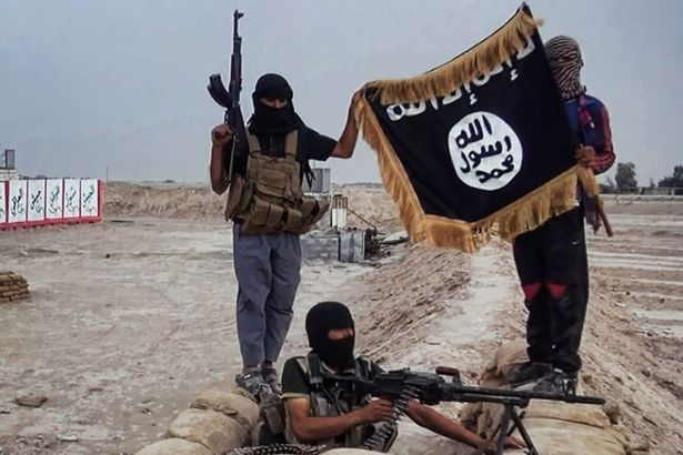 Militants of the Islamic State of Iraq and the Levant (ISIL) posing with the trademark Jihadists flag after they allegedly seized an Iraqi army checkpoint in the northern Iraqi province of Salahuddin