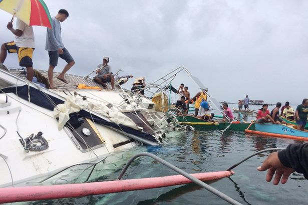 Filipino fishermen recovering a drifting yacht in the seas off Barobo town in Surigao del Sur province, Philippines, 27 February 2016. Manfred Fritz Bajorat was found dead inside a drifting yacht