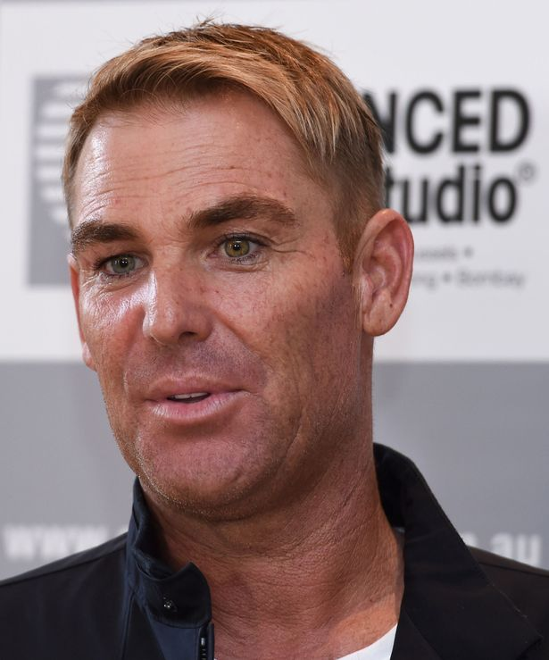 Shane Warne speaks to the media during a media opportunity at Advanced Hair Studio on March 18, 2016 in Melbourne, Australia