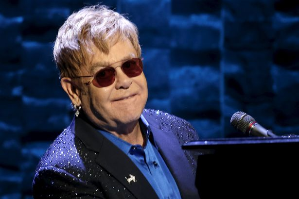 Singer Elton John performs at the Hillary Victory Fund