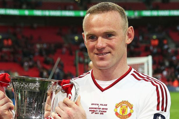 Wayne Rooney of Manchester United poses for photographs with the trophy after The Emirates FA Cup Final match between Manchester United and Crystal Palace