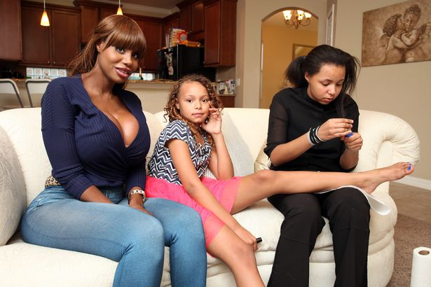 Nina Colada with her daughters Juliana (L) and Ymahni (R) at their home