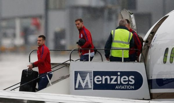 England's Tom Heaton and Jordan Henderson arrive back at Manchester Airport