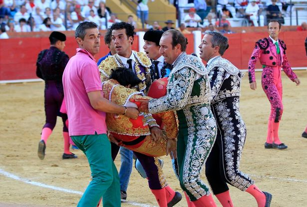 Spanish bullfighter Victor Barrio (bottom), 29, is gored during a bullfight