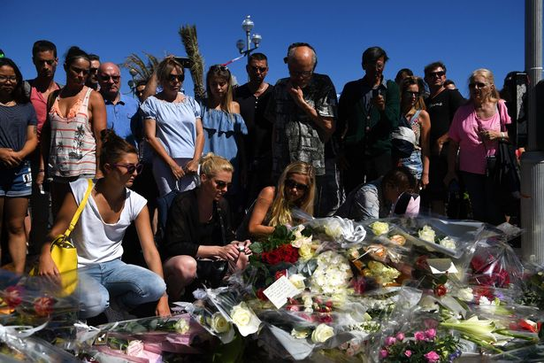 People visit the scene and lay tributes to the victims of a terror attack on the Promenade des Anglais