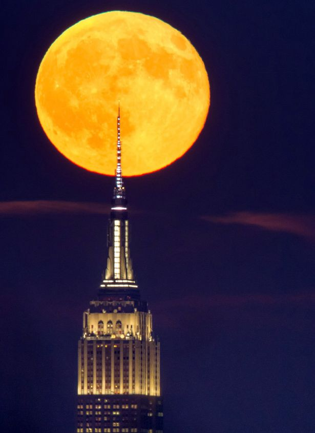 The Full sturgeon moon 18th August 2016 crossing the spire of the Empire State Building