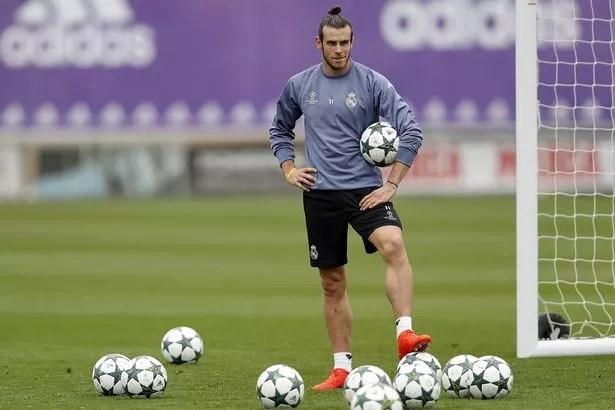 Gareth Bale looks on