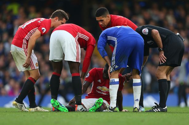 Image result for eric bailly down for an injury during manchester united game against chelsea