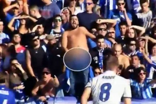 A fan shows his penis whilst others reveal their bottoms to put of Cristiano Ronaldo taking a penalty for Real Madrid