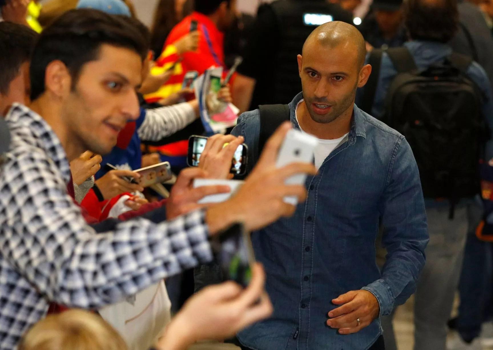 Javier Mascherano arrives at Manchester Airport