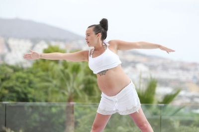Stephanie Davis displays bare baby bump as she does yoga