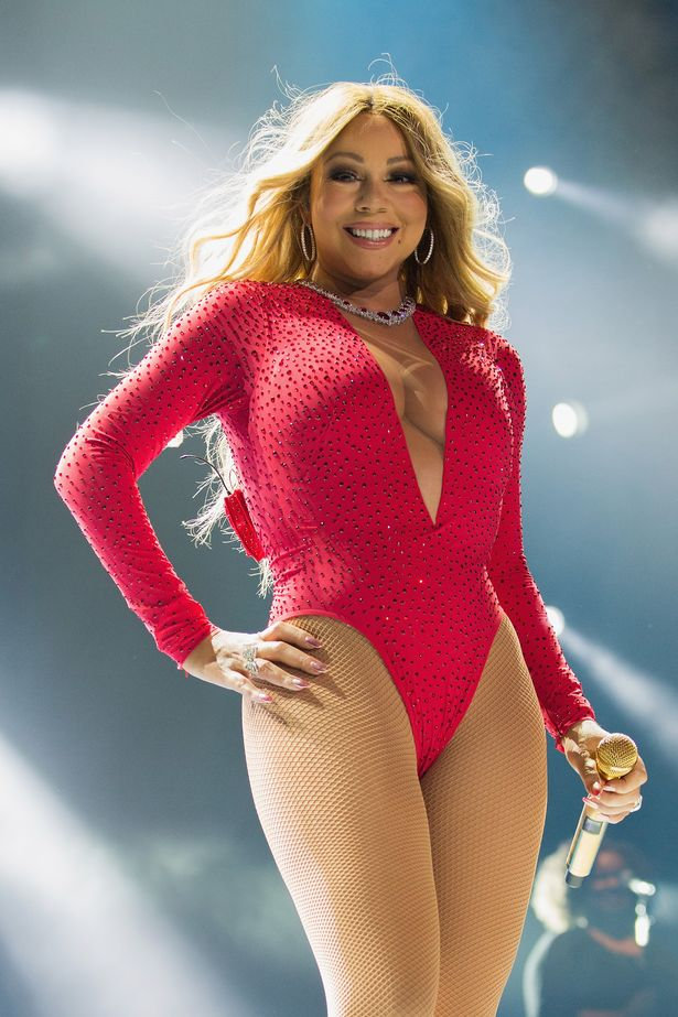 "Singer Mariah Carey performs on stage during her ""Sweet Sweet Fantasy Tour"" at Arena Ciudad de Mexico"