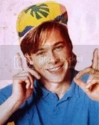 brad pitt in the 80s when he is young and wearing a hat and smiling and pointing