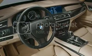 BMW has a flat dashboard and controls on the passenger side so passengers can operate the GPS while the driver drives