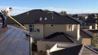 Roof cleaning right to the edge, using Go Cleaning's own custom made roof cleaner, designed by Go Cleaning