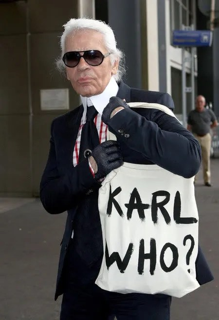 Karl Lagerfeld in Nice Airport carrying a Karl Who? bag