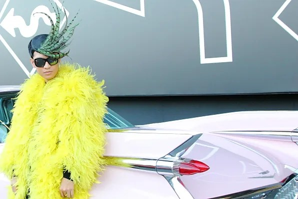 Bryanboy in his big bird outfit outside the Prada Tokyo show venue