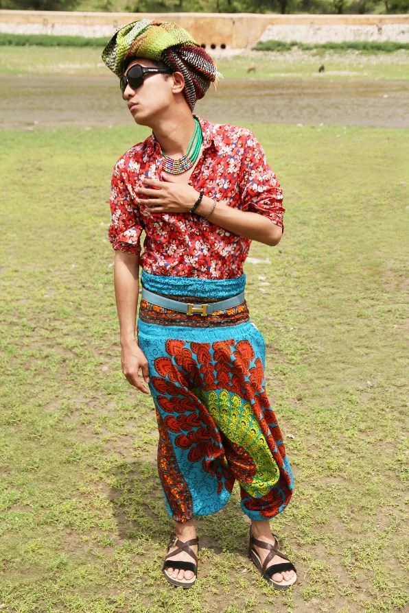 Bryanboy wearing psychedelic colours at the Amber Palace fields