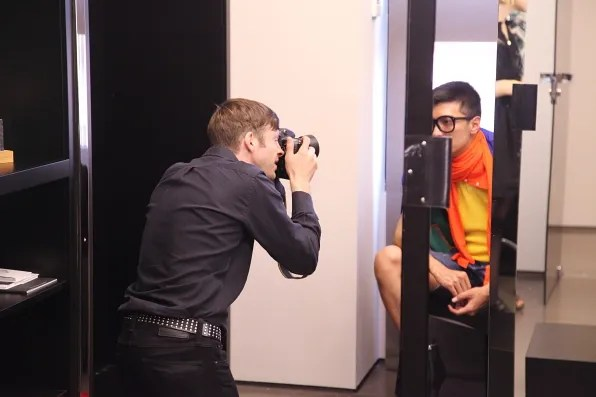 Nowness photographer Morgan photographing Bryanboy at the DSquared2 showroom in Milan.