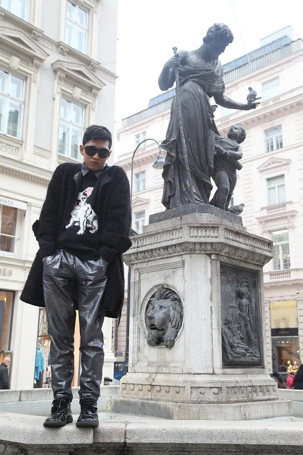Bryanboy standing on a fountain, Vienna