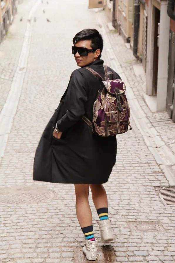 Bryanboy wearing a backpack at Gamla Stan in Stockholm