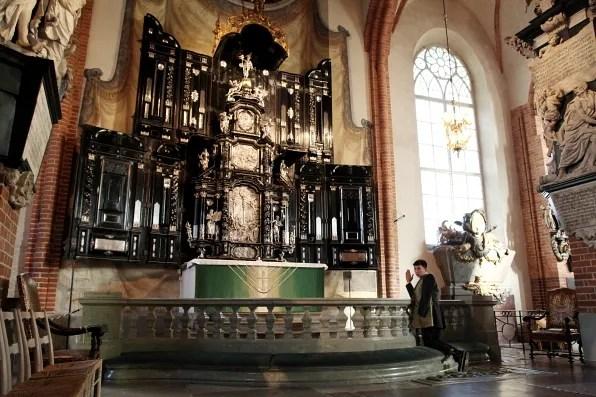 Bryanboy praying inside Storkyrkan