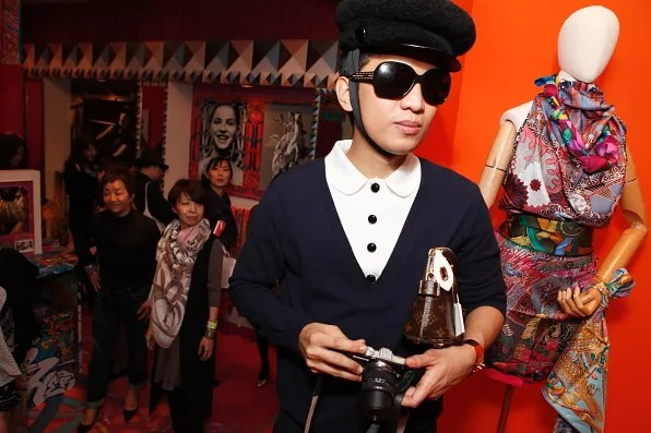 Bryanboy taking photos inside Hermes pop-up store, Tokyo
