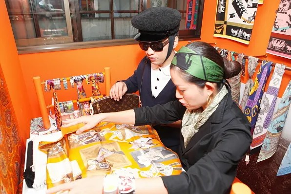 Hermes Japan Public Relations representative shows Bryanboy a silk scarf