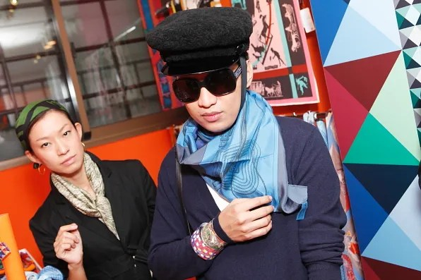 Bryanboy trying on paper Hermes bracelets