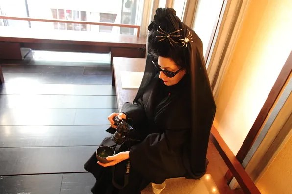 Diane Pernet photographing her tea at CHA Ginza, Tokyo