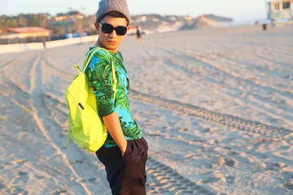 Bryanboy wearing a fluorescent yellow backpack