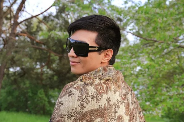 Bryanboy wearing a brown and gold shawl.