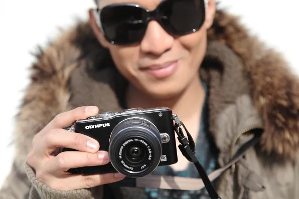 Bryanboy carrying an Olympus Pen E-PL3 camera