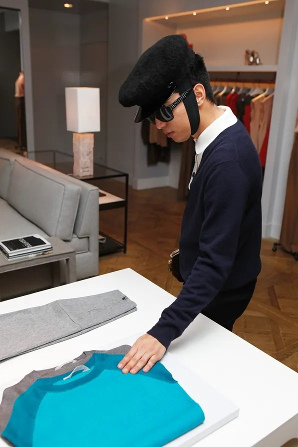 Bryanboy touching a Reed Krakoff sweater